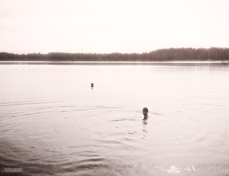 Swimming in Lake Kuorevesi in Mantta, Finland.