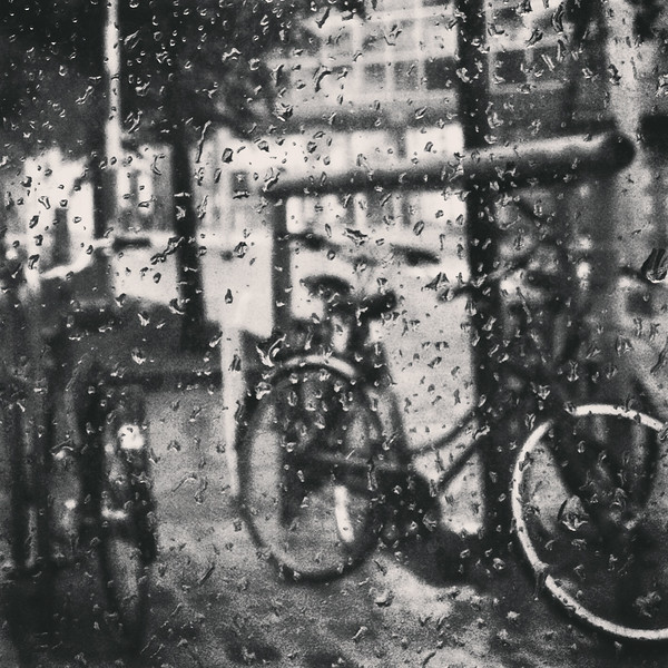 Rain falling on bike outside of the Meininger Hotel in Amsterdam.